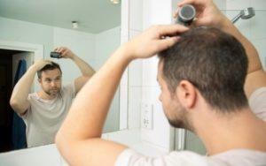 man using biothik hair fibres